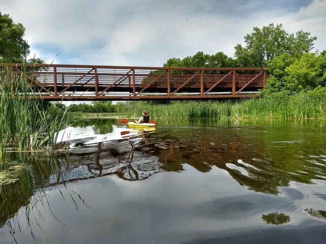 kayaking under a bridge