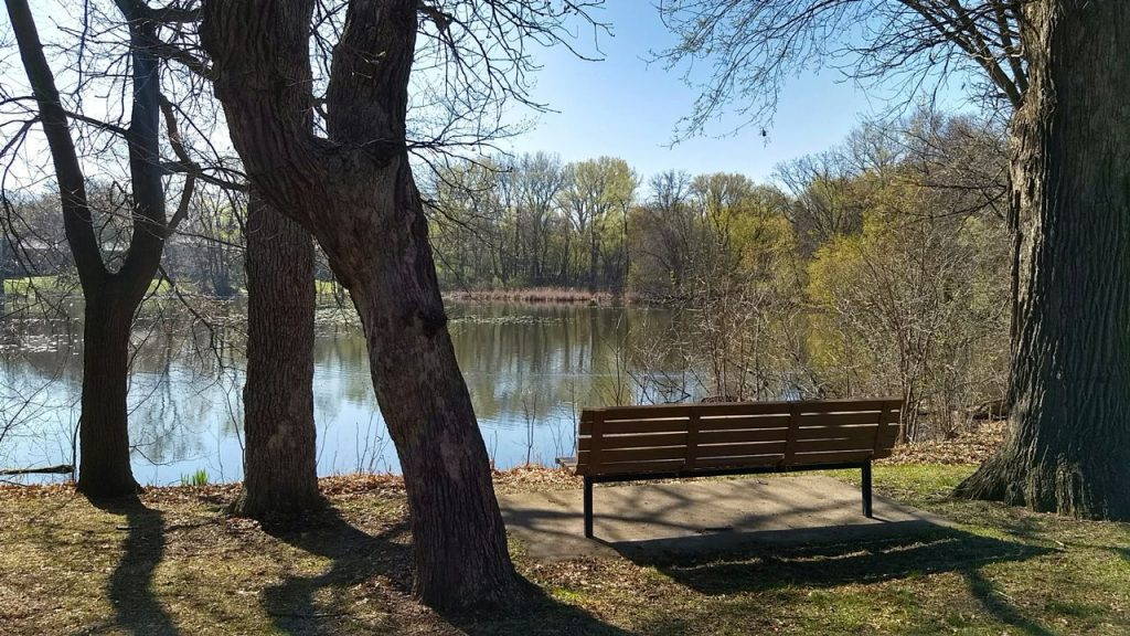 park bench next to highland lake