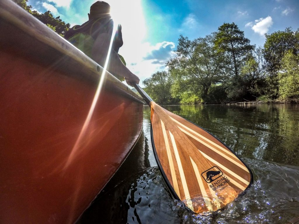 canoeist bending branches paddle