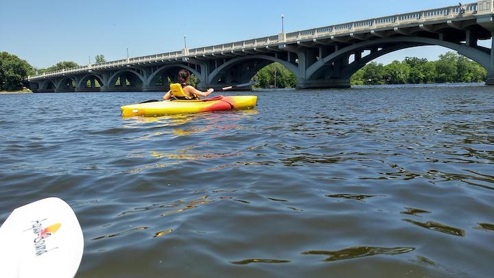kayaking the mississippi river under Anoka's ferry street bridge