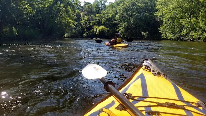 kayaking in a little bit of rapids