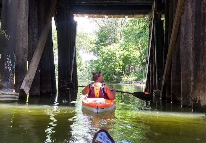 kayaking under the wooden bridge